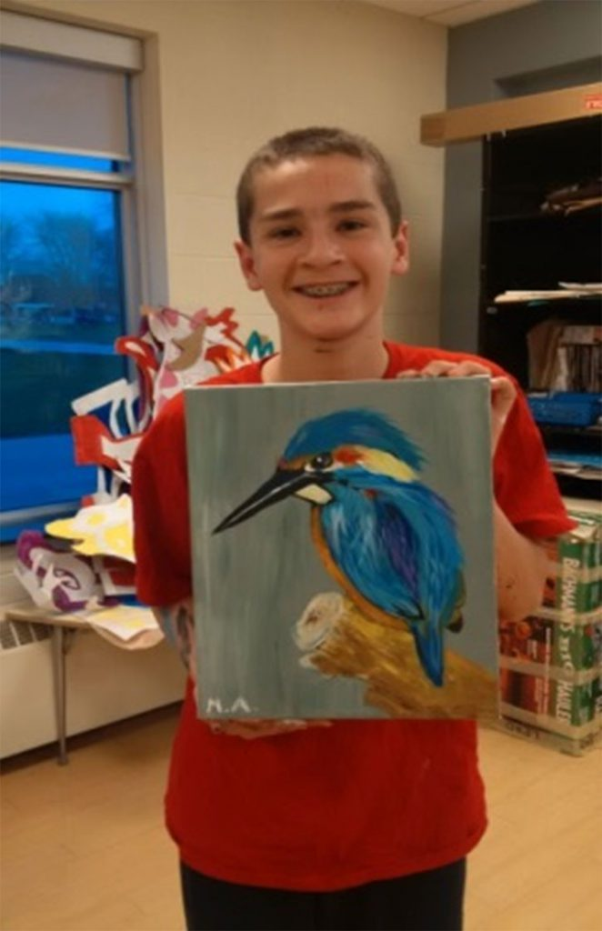 Students displaying their art work