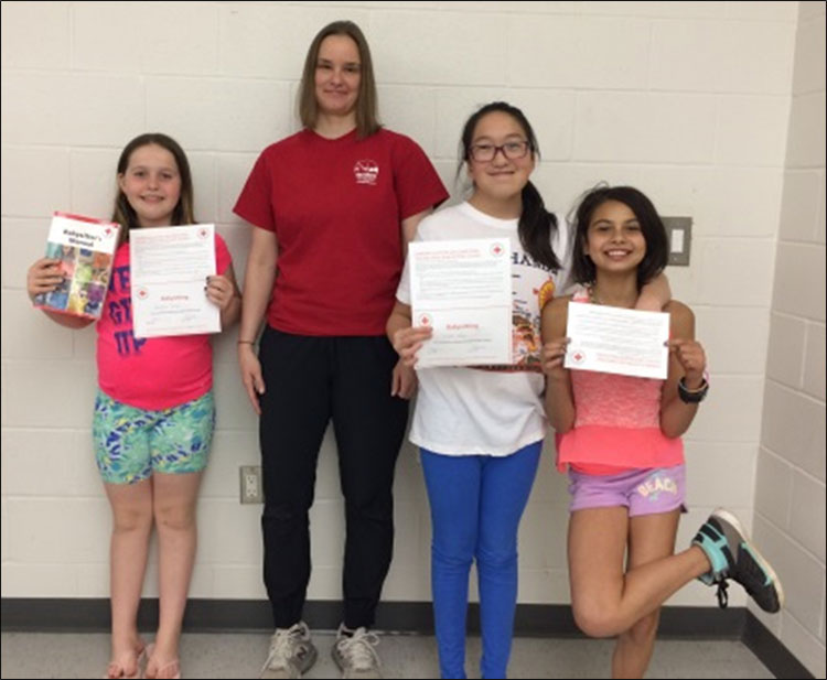 Students with their certificates after completing the babysitter's course