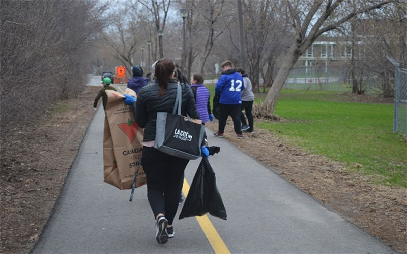 """Figure 8: CJL residence students and staff participating in the """"Cleaning the Capital"""" event"""