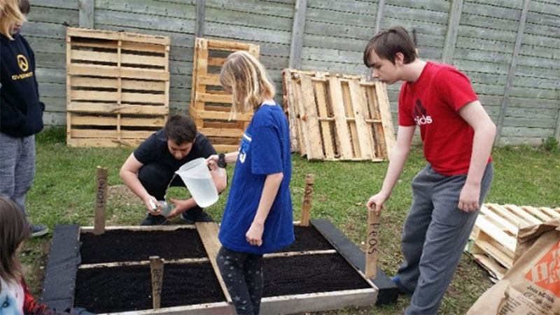 Figure 29: Students building raised planting beds