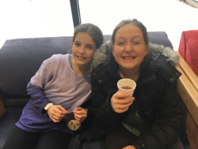 Enjoying a cup of hot chocolate with a friend